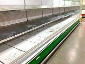 Empty obsolete and dirty supermarket shelves in Cuba
