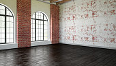 Empty loft interior with windows