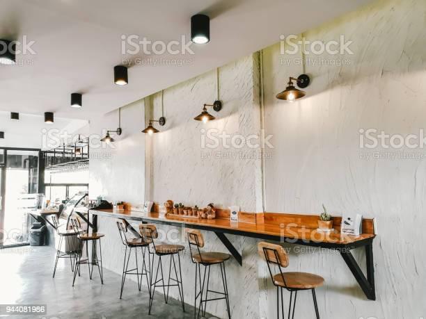 Empty on people coffee shop interior design with chairs and white picture id944081986?b=1&k=6&m=944081986&s=612x612&h=ku0 gx4fmh8jwujg21s77aeqnvlu6ghzq2tp 7z ryu=