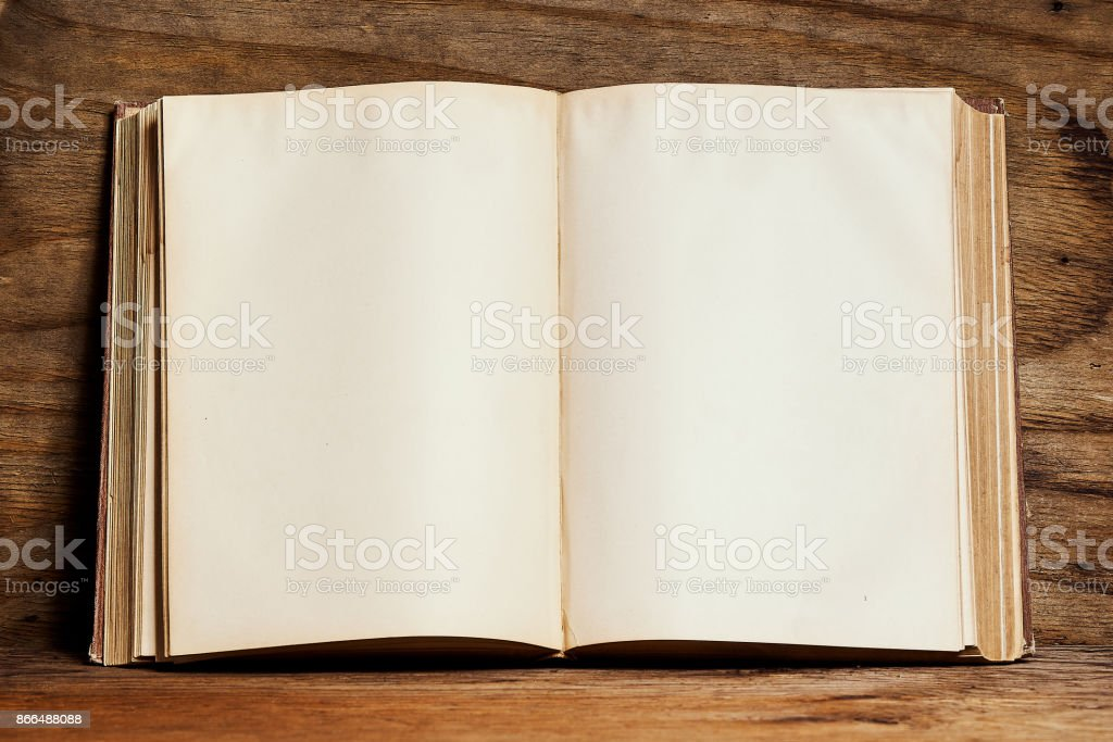 empty open book on a bright wooden shelf on the playwood wall stock photo