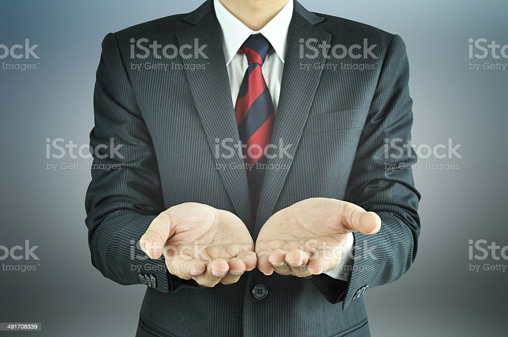 Empty open hands of businessman stock photo