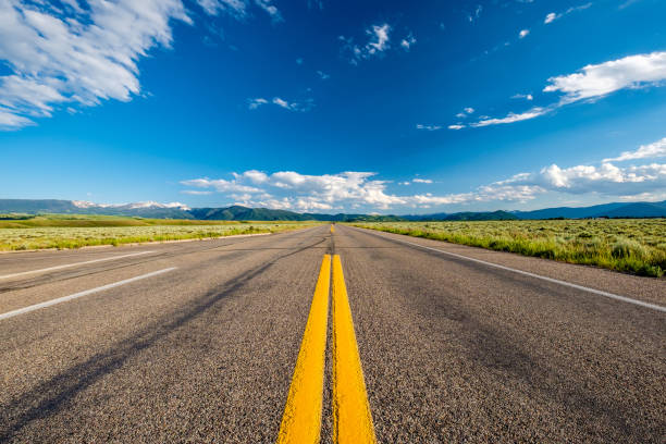 empty open highway in wyoming - long stock pictures, royalty-free photos & images