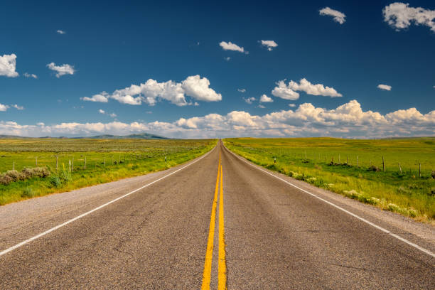 empty open highway in wyoming - straight stock photos and pictures