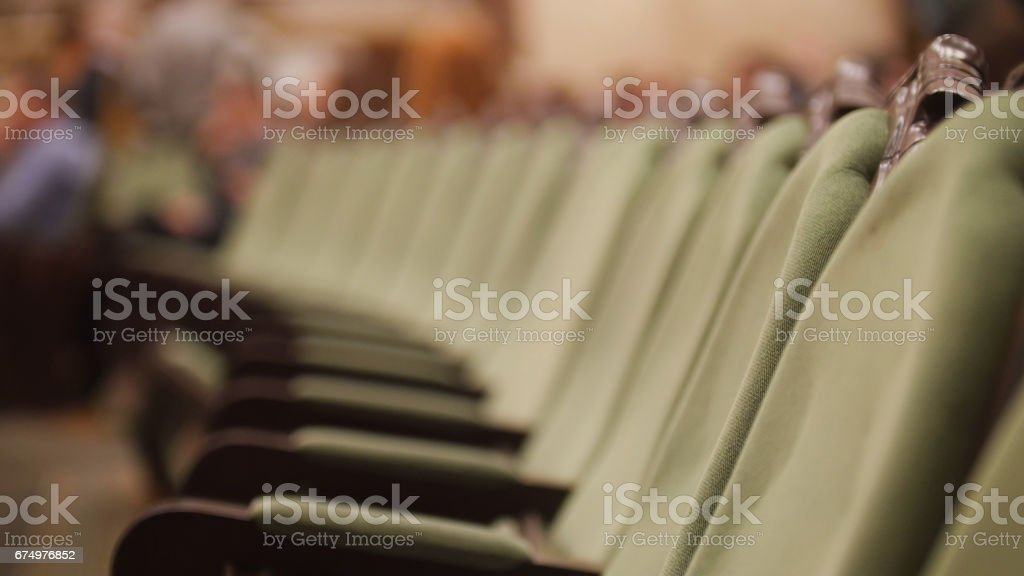 Empty opera concert hall - green chairs without spectators stock photo