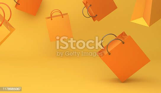 istock Empty orange color shopping bag on the yellow background, copy space text, Design creative concept for halloween day or autumn sale event. 1178685067