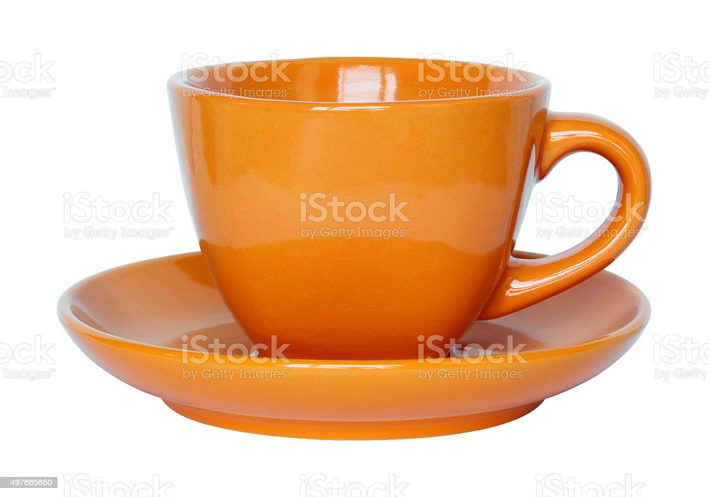 empty orange cup and saucer isolated on white stock photo