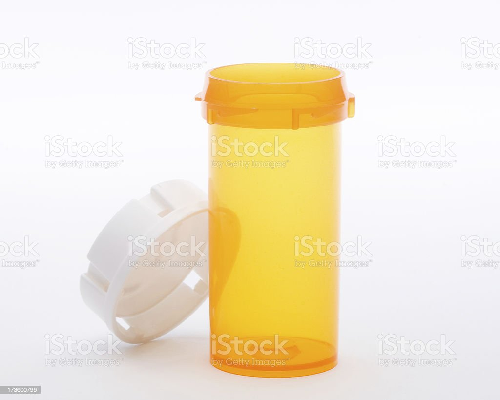 Empty orange pill bottle with white cap on white stock photo