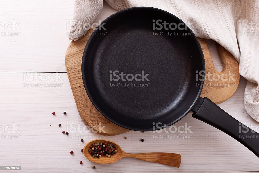 Empty pan on wooden deck table with tablecloth stock photo