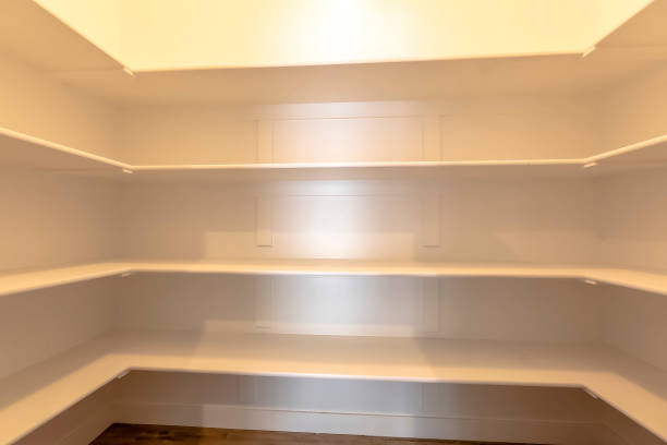 Empty Pantry Illuminated room with empty shelves stock photo