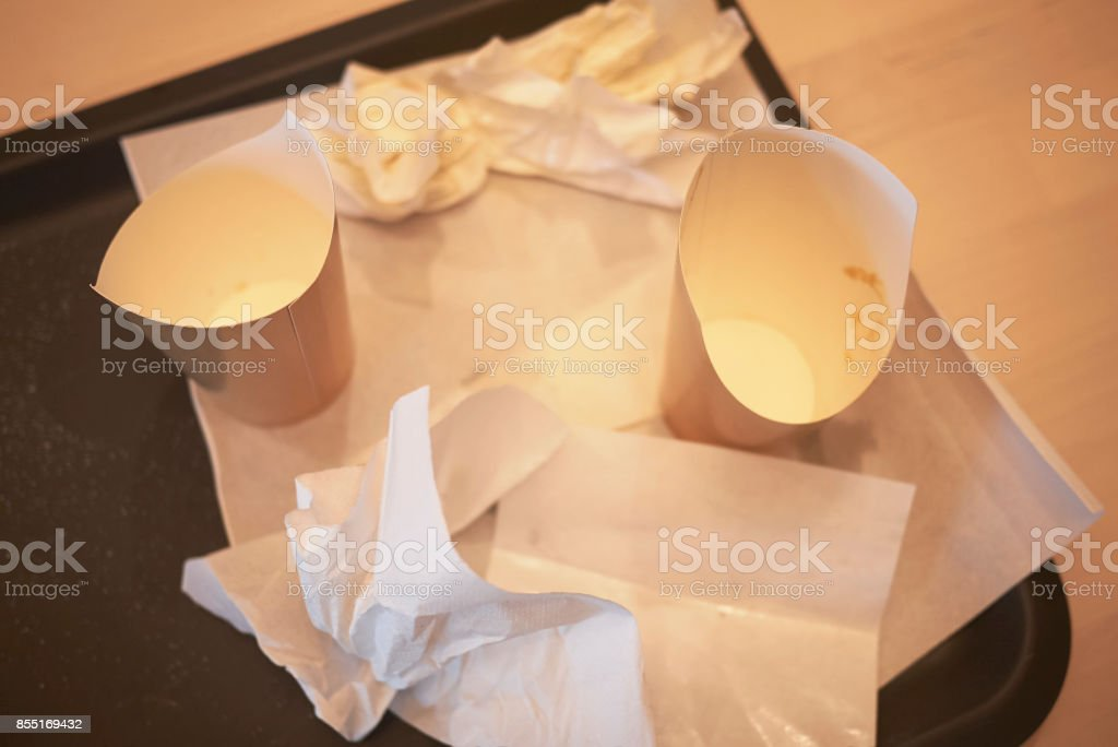 Empty paper cups and napkins stock photo