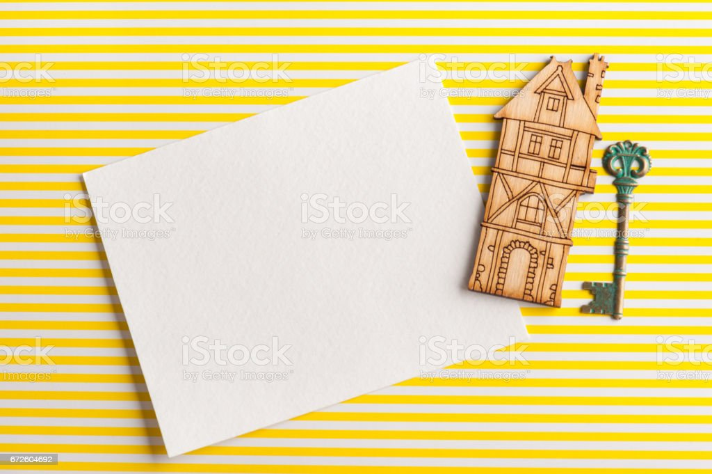 Empty paper note, wooden house and key stock photo