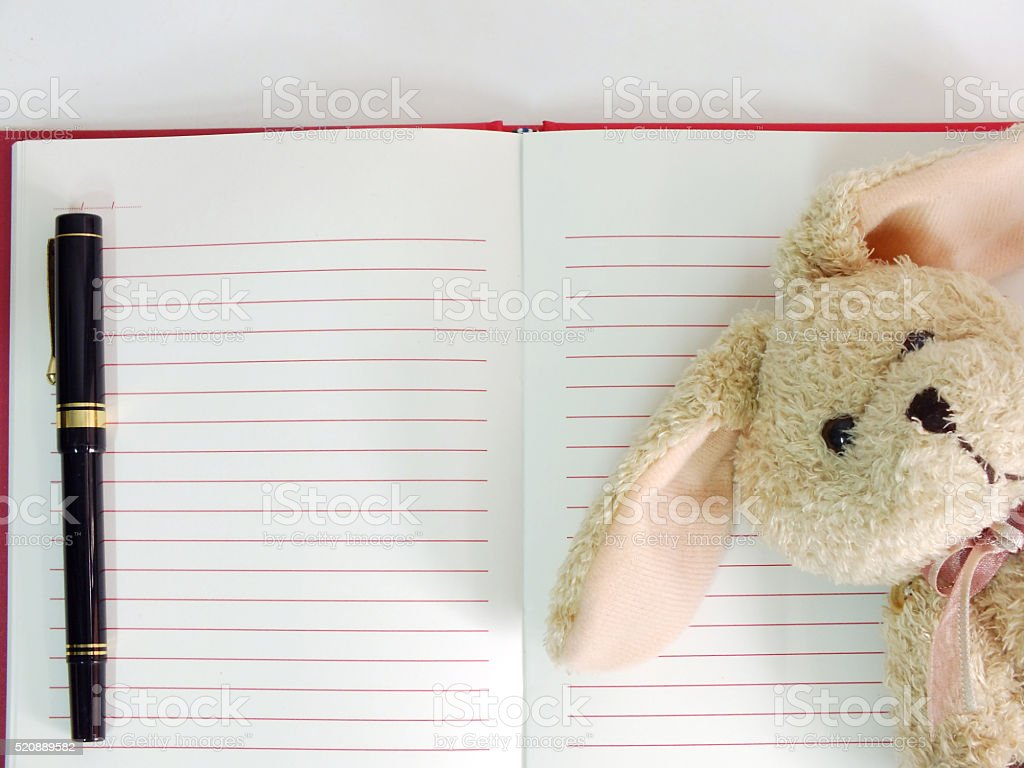 Empty Paper Notebook Background And Cute Rabbit Doll Royalty Free Stock Photo