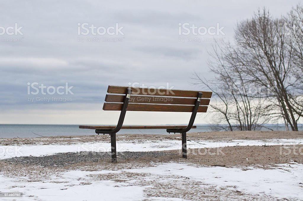 Empty Park Bench in Winter royalty-free stock photo