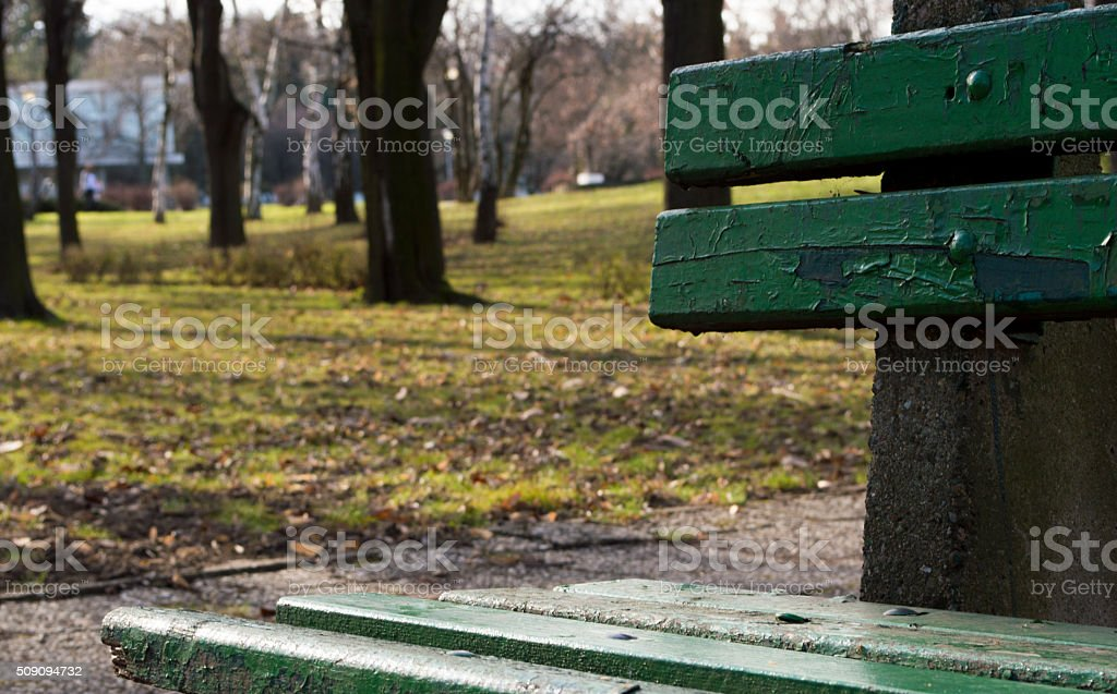 Empty park bench stock photo