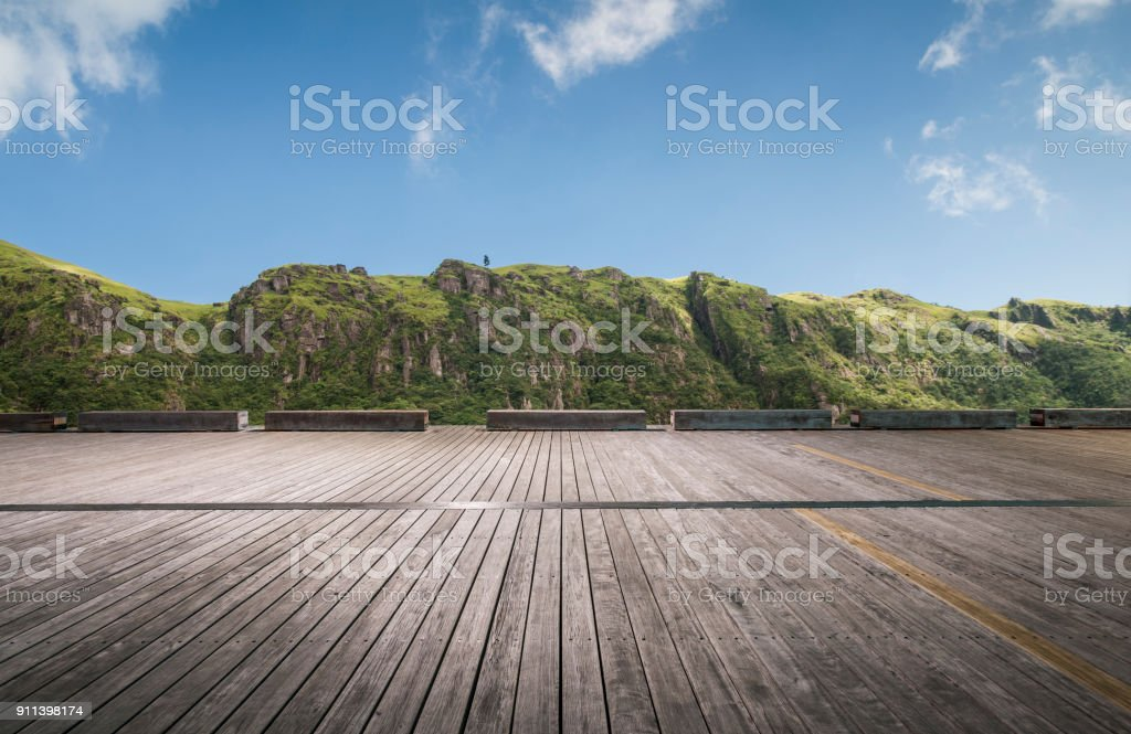 empty parking lot front of mountain ranges stock photo
