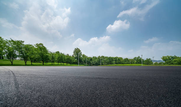 Empty Parking Lot Horizon over Parking Lot parking lot stock pictures, royalty-free photos & images