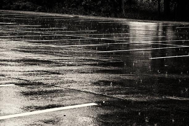 Empty parking lot under the rain stock photo