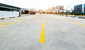 Empty parking lot with modern buildings.