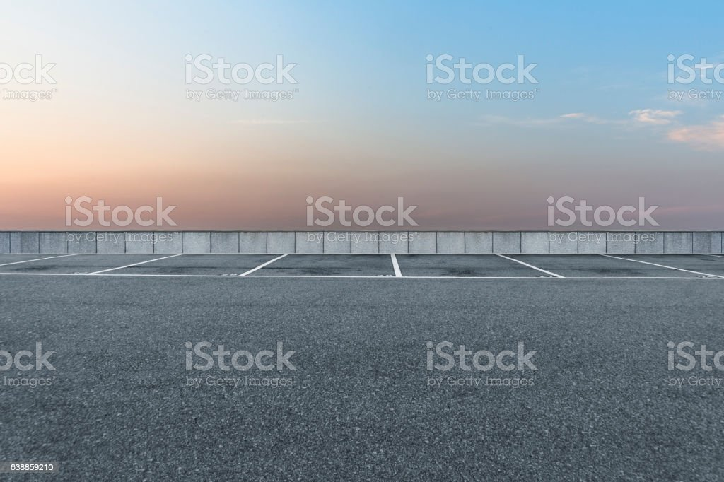 Empty parking lot with sky at twilight stock photo