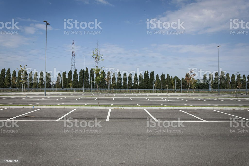 Empty parking lot with trees stock photo