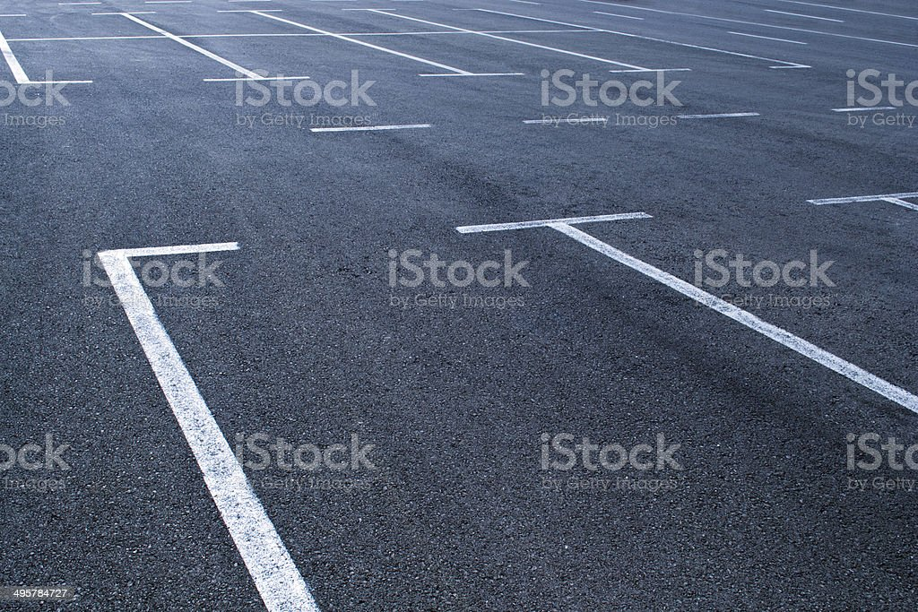 Empty parking lot with white lines stock photo