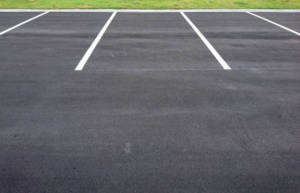 Empty parking with white marking line Empty parking with white marking line on floor parking lot stock pictures, royalty-free photos & images