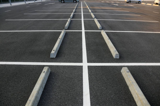 Empty parking with white marking line Empty parking with white marking line parking lot stock pictures, royalty-free photos & images