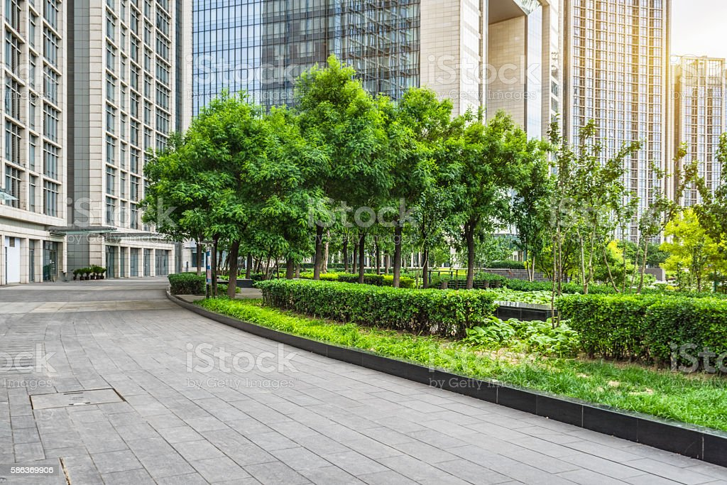 empty pavement and modern buildings in city stock photo