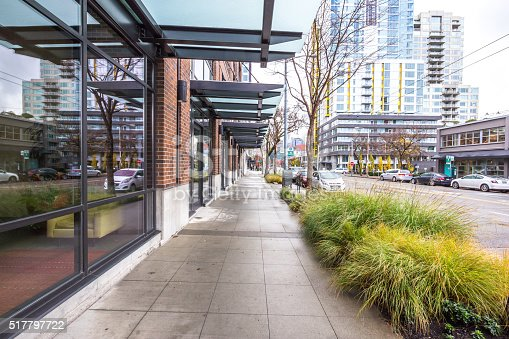 empty pavement front of modern buildings in seattle