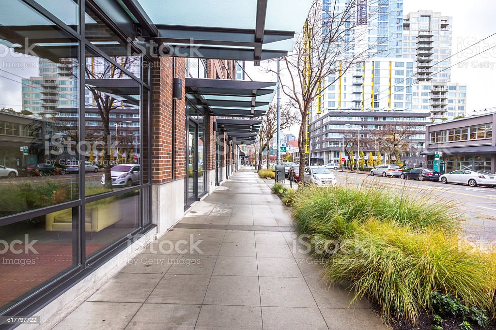 empty pavement front of modern buildings in seattle stock photo