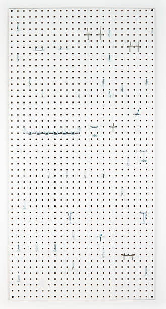 Empty Pegboard With Hooks For Organizing stock photo