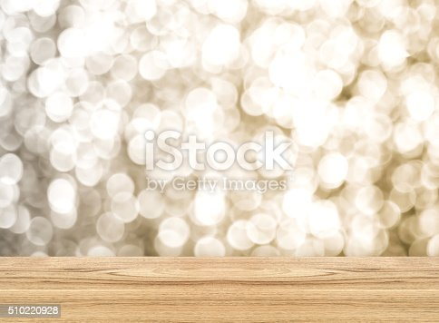 istock Empty perspective room with sparkling bokeh wall and wooden 510220928
