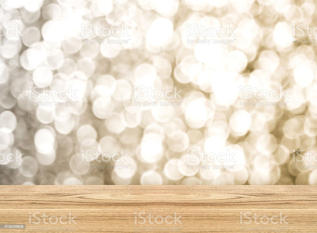 Empty perspective room with sparkling bokeh wall and wooden stock photo