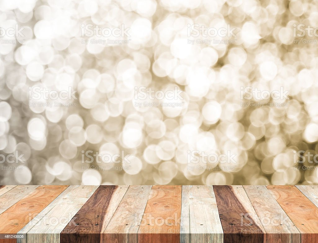 Empty perspective table with sparkling bokeh wall stock photo