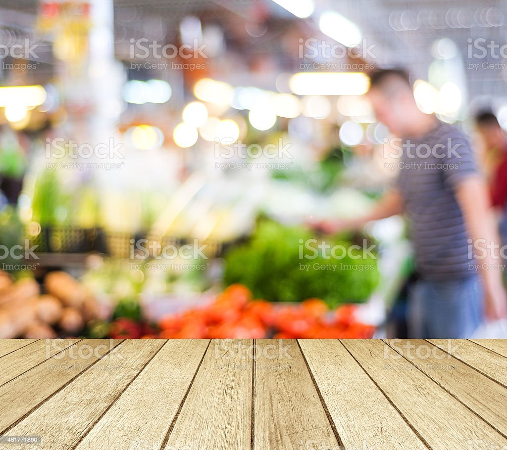 Empty perspective wood and blur market with bokeh background stock photo
