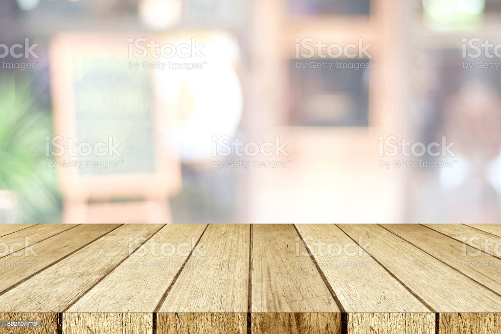 table top background blurred empty perspective wood tabletop over blur restaurant with bokeh light background food and perspective wood tabletop over blur restaurant with bokeh