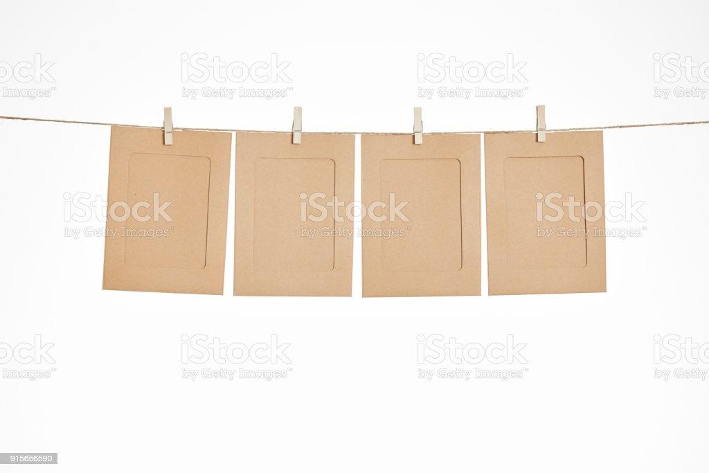 empty photo frame hanging on rope stock photo