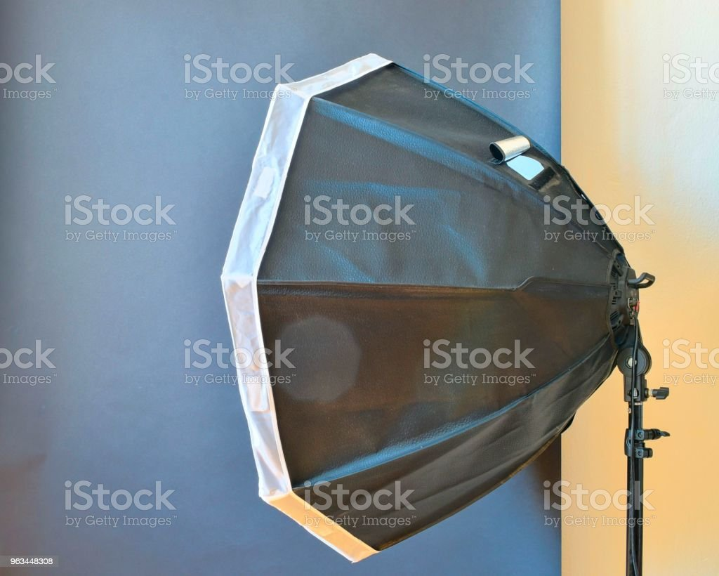 Empty photo studio with lighting equipment. Black background in photo studio - Zbiór zdjęć royalty-free (Aparat fotograficzny)