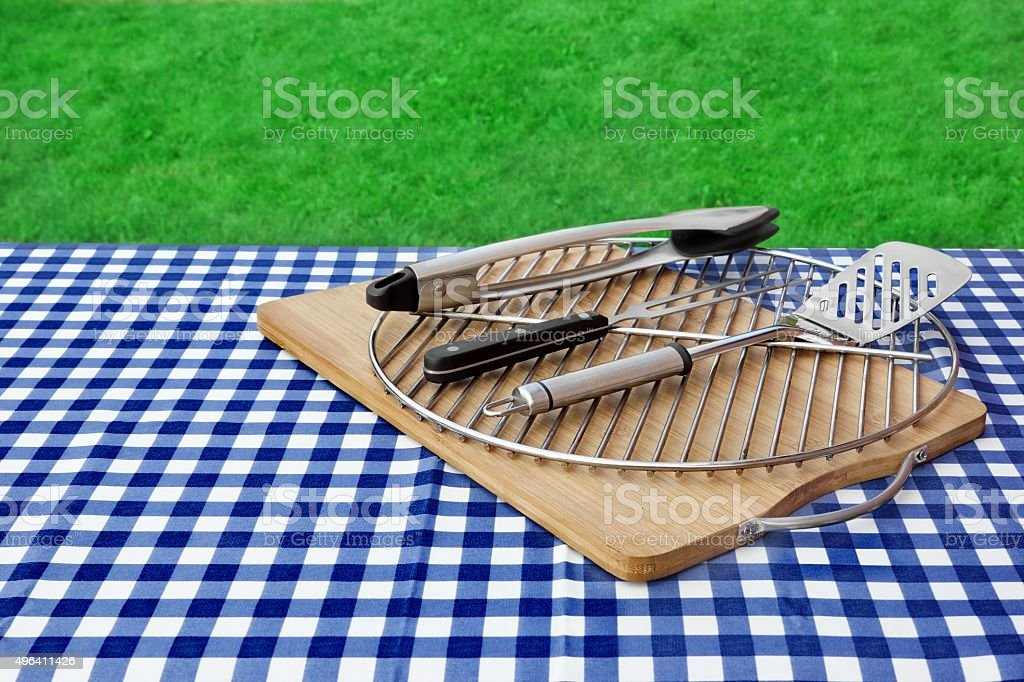 Empty Picnic Table, Checkered Tablecloth,  Grid, BBQ Grill Tools stock photo