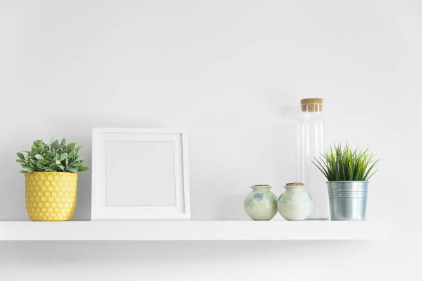 Empty picture frame on a floating shelf