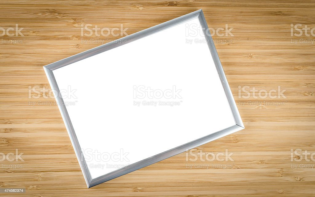 Empty picture frame on a wooden background stock photo