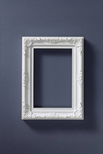 Empty picture frame on dark background stock photo