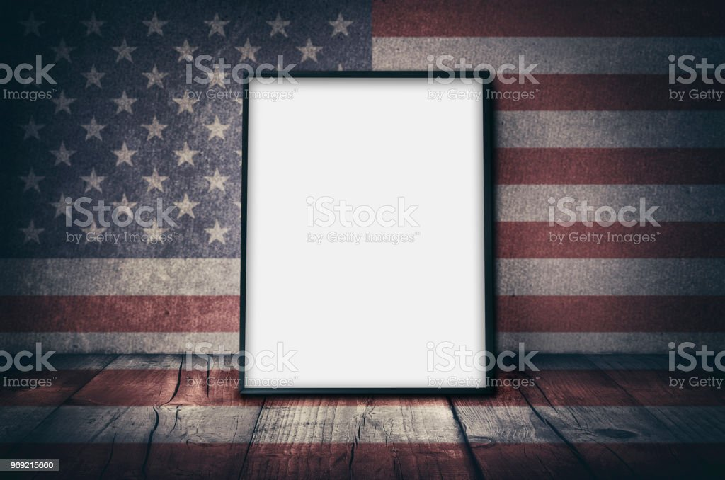 Empty picture frame with USA national flag stock photo