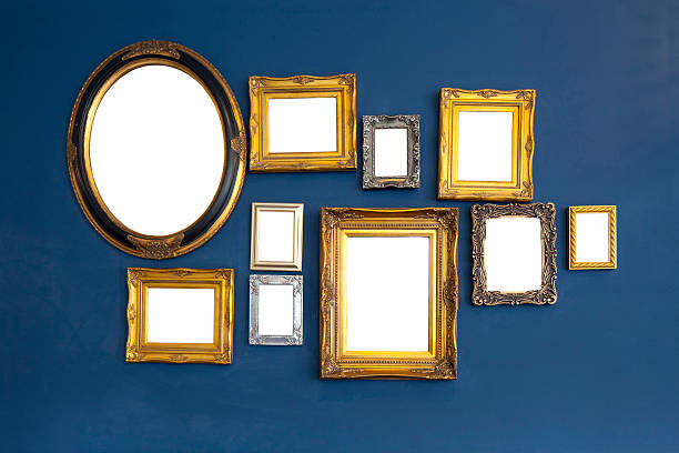 empty picture frames on wall stock photo