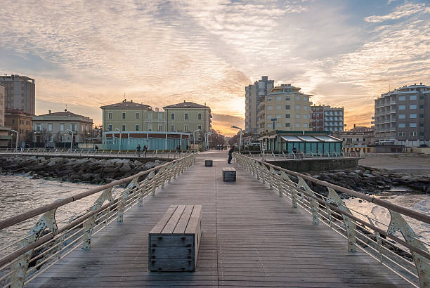 Empty pier on the sea in Pesaro during the sunset stock photo