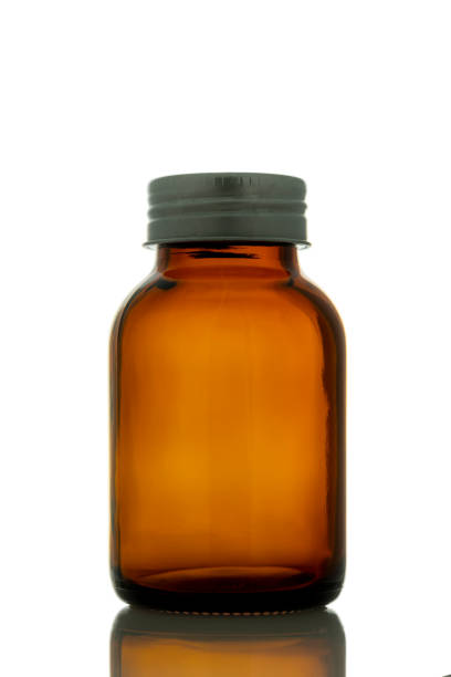 empty pill bottle with cap stock photo