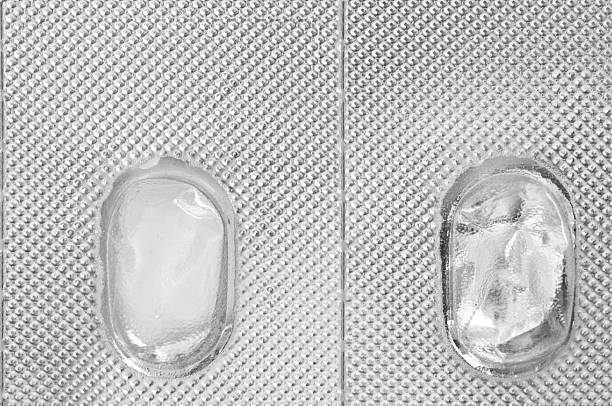 Empty Pill Packaging Two empty pill packages. pill container stock pictures, royalty-free photos & images