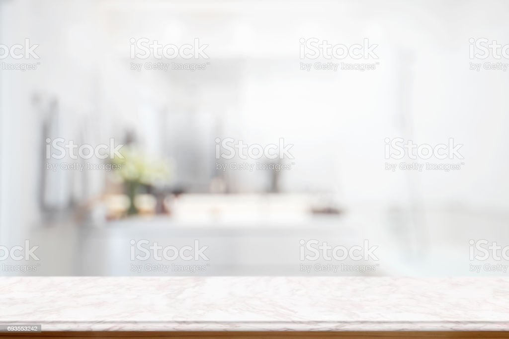 Empty pink marble top table for product display montage with blurred bathroom interior Bckground. stock photo