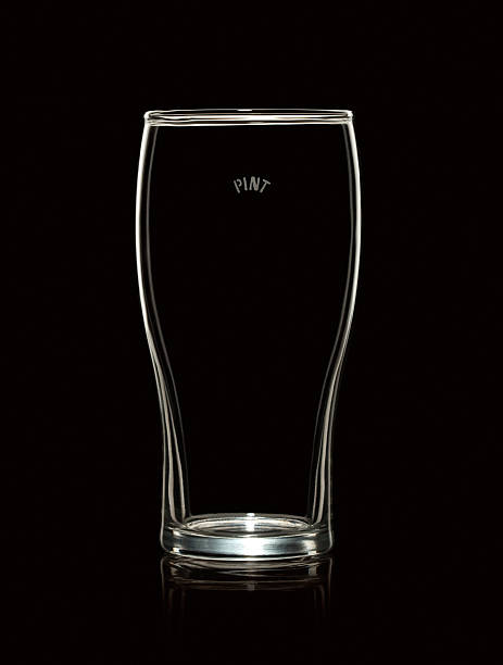 Empty Pint Beer Glass Isolated on Black Background stock photo