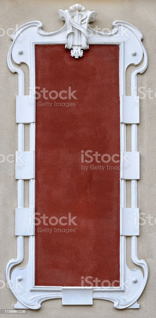 empty plaster frame stucco on the facade of the building in retro...